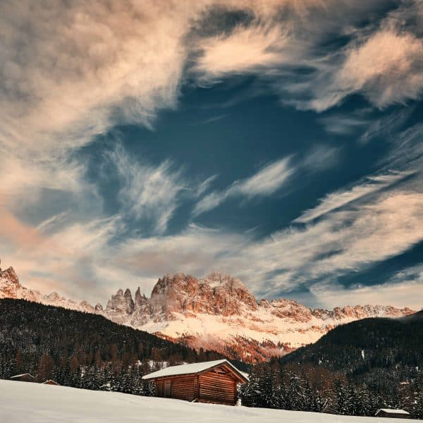 Little Hut in a snowy mountain, clear blue sky with cute clouds in the background - how to slow down