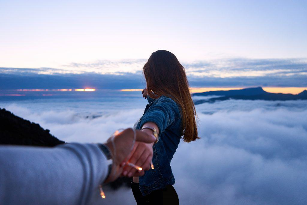 Woman holding someones hand while looking to horizon, how to let go