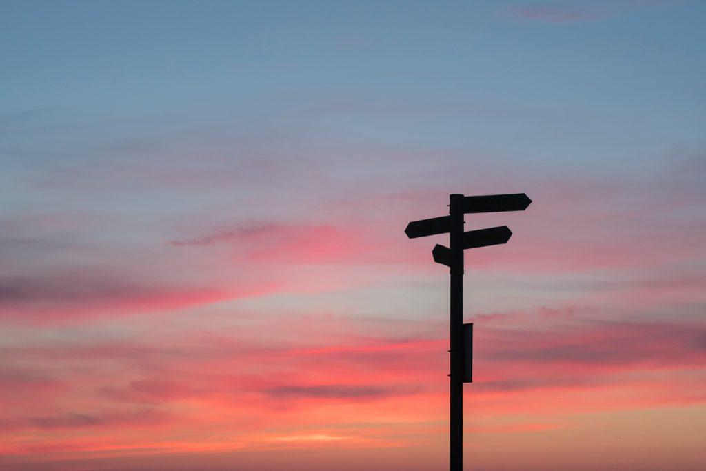 Signs in front of sunset - How to Let go - Life Lessons I wish I knew earlier.