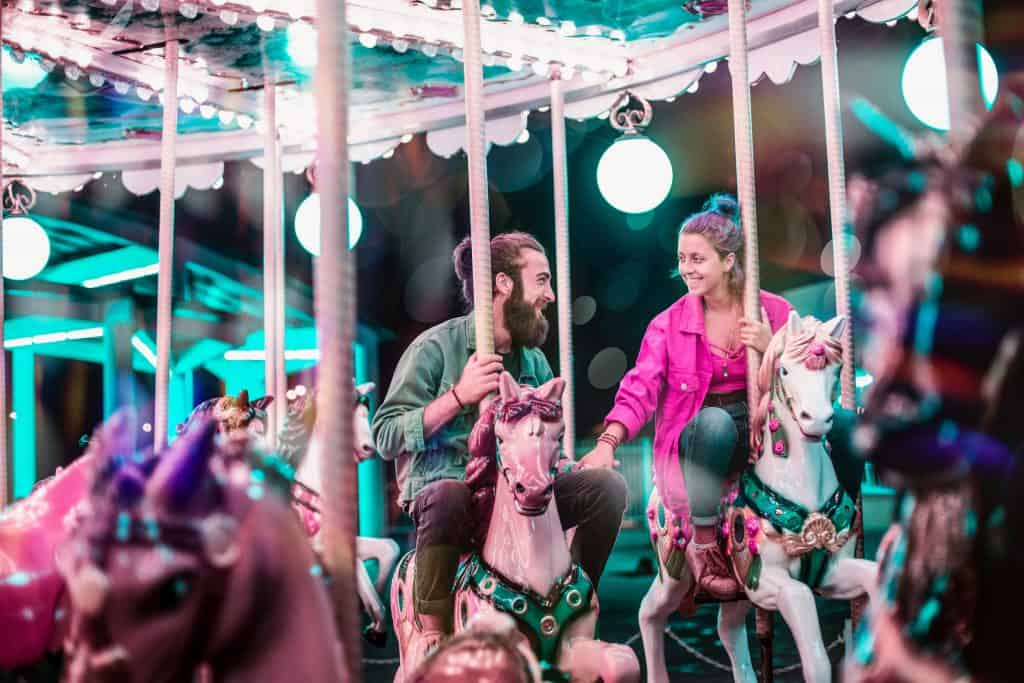 Couple riding a carousel