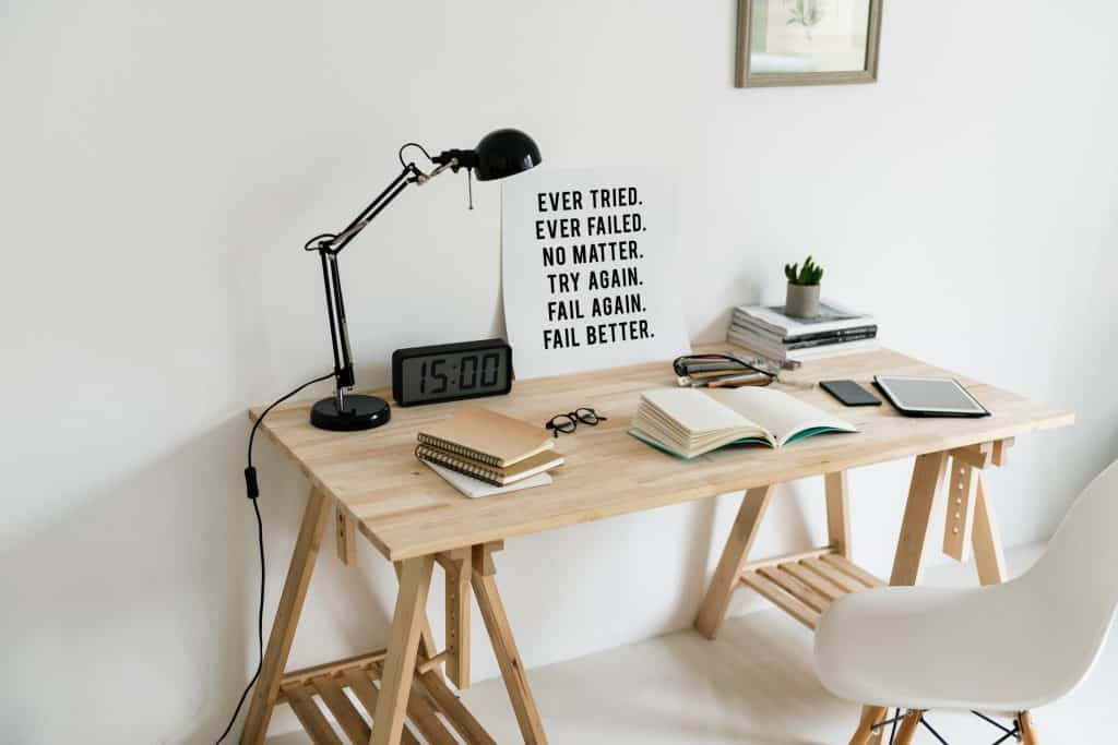 Styled Desk with Inspirational Quote leaning on white wall